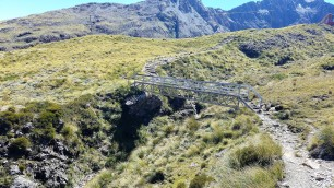 The bridge along the ridge is right at the end